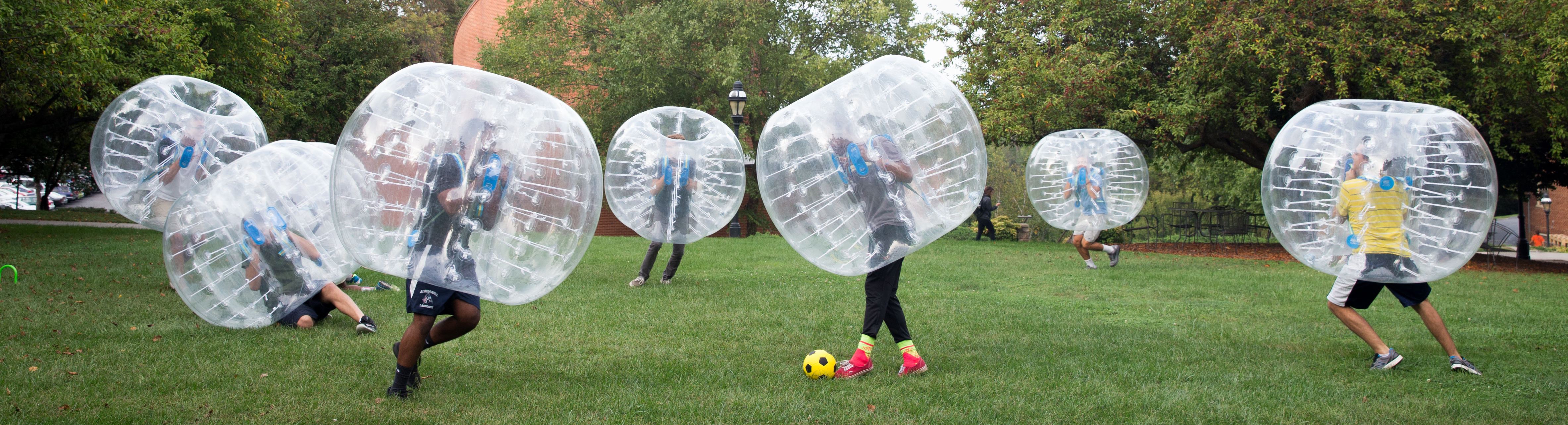Students playing bubble soccer.