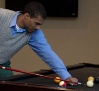 students play billiards in student center