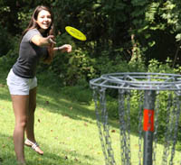 students play disc golf
