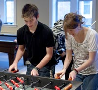 students play foosball in student center