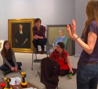 students examine art