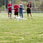 L-R: Keaton Ellis, James Dodson, Olivia Moore, and teacher Caitlin Unterman practice flying and landing a drone during coursework on a mock mission to Mars in Ms. Unterman
