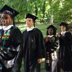 Graduates process into the Dell