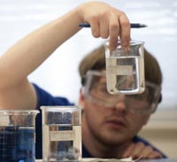 A student examines water samples.