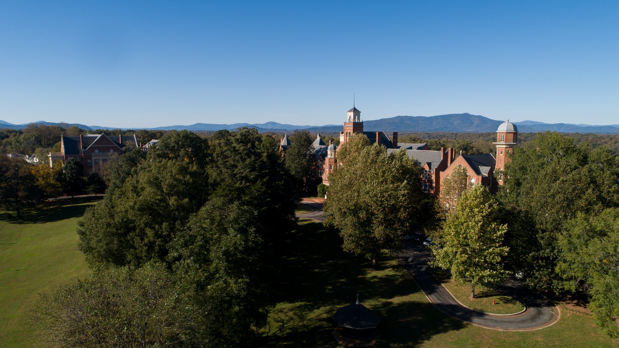 Aerial photo of campus with the blue sky and mountains in the background
