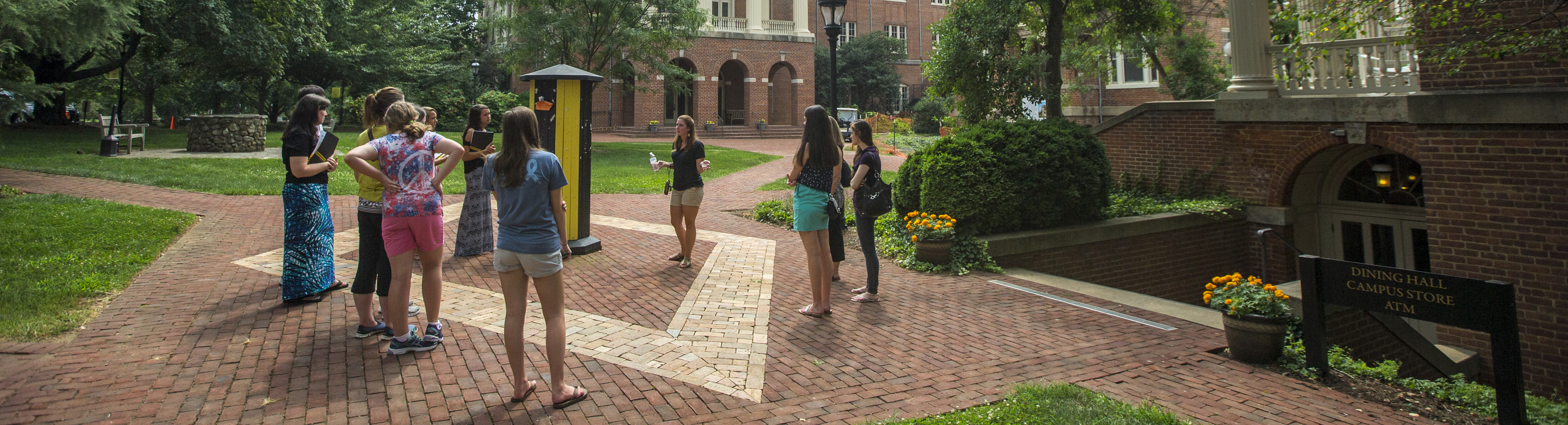 Photo of students talking a tour of campus
