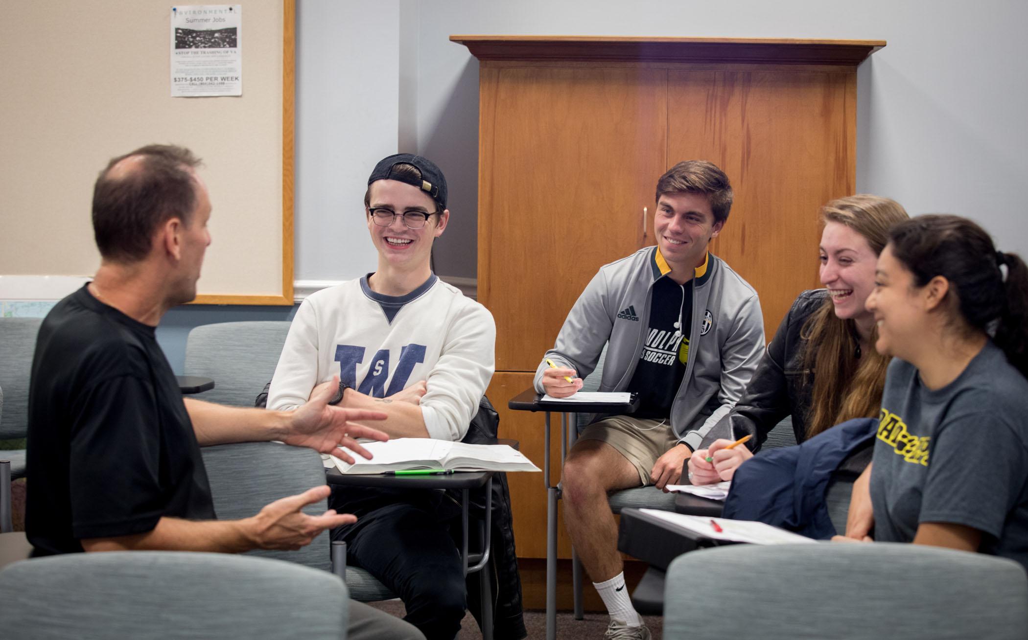 Economics professor Jeff Heinfeldt leads group discussion.