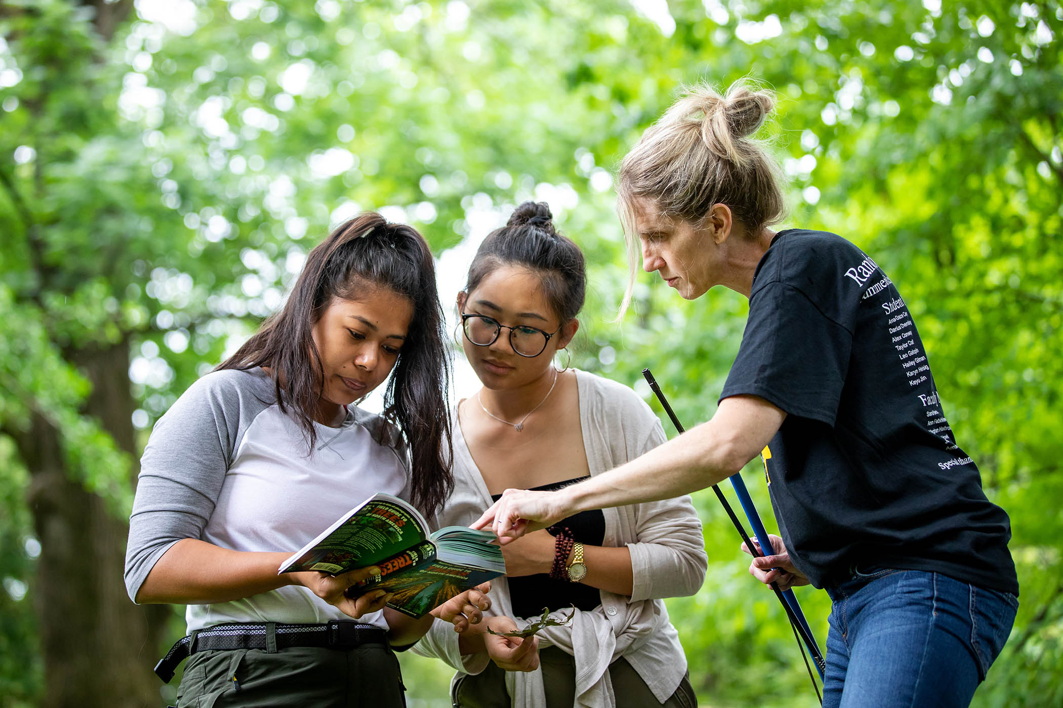 Environmental science professor Karin Warren helps summer research students conduct a forest inventory.