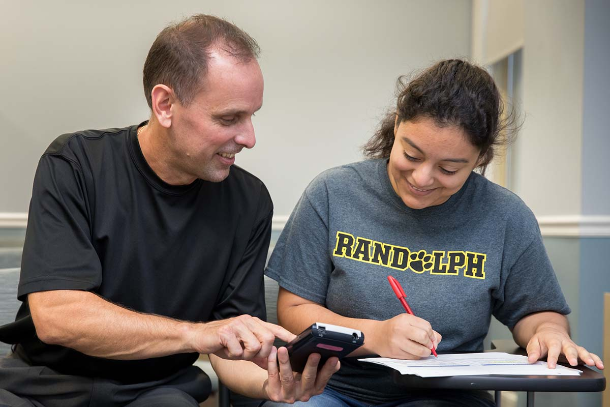 Professor Jeff Heinfeldt works with a student.
