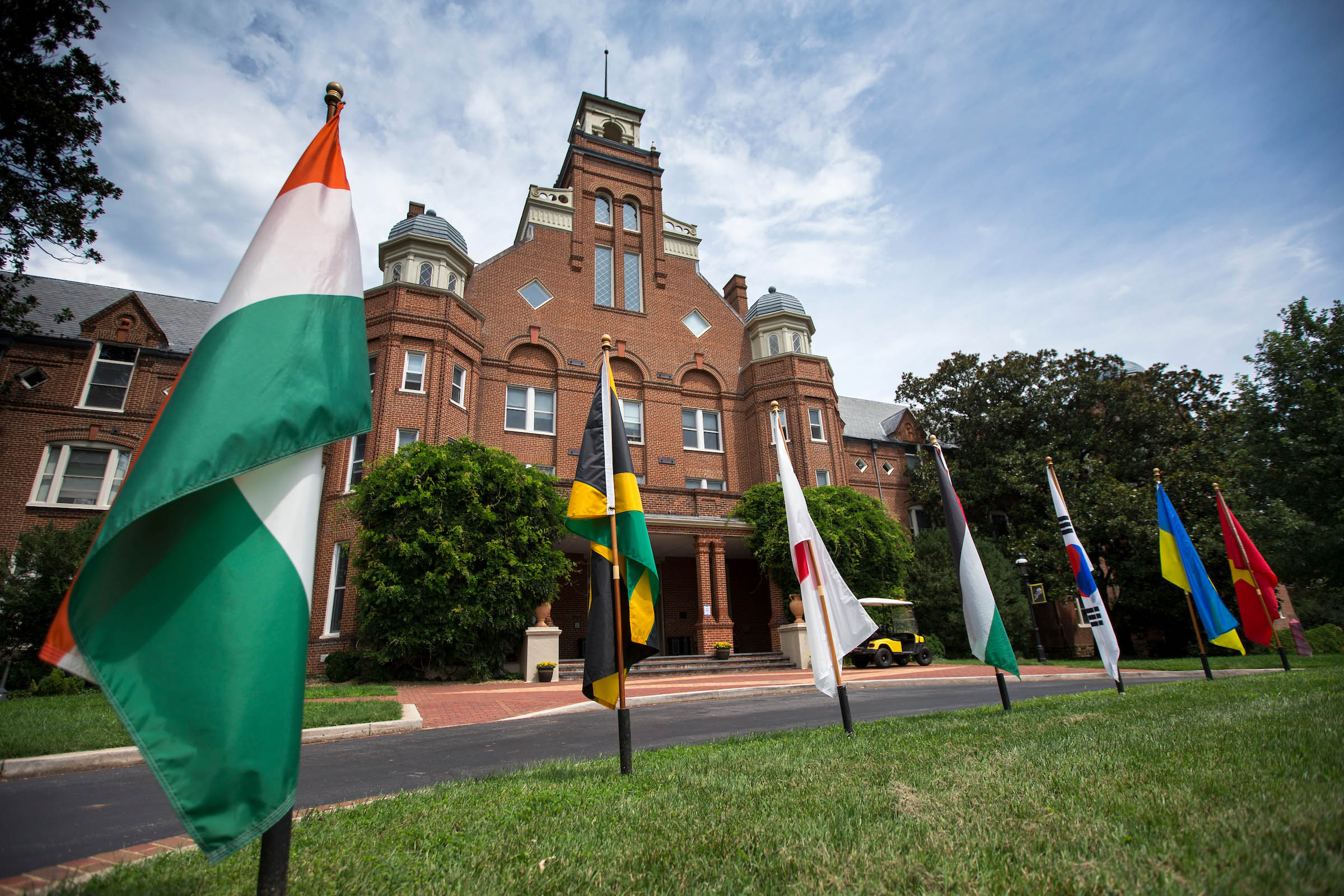 Flags of the countries of Randolph international students fly in front of Main Hall.