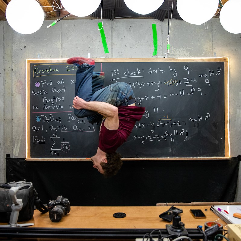 Randolph math professor Michael Penn throws in one of his signature backflips while recording a video for his popular YouTube channel.