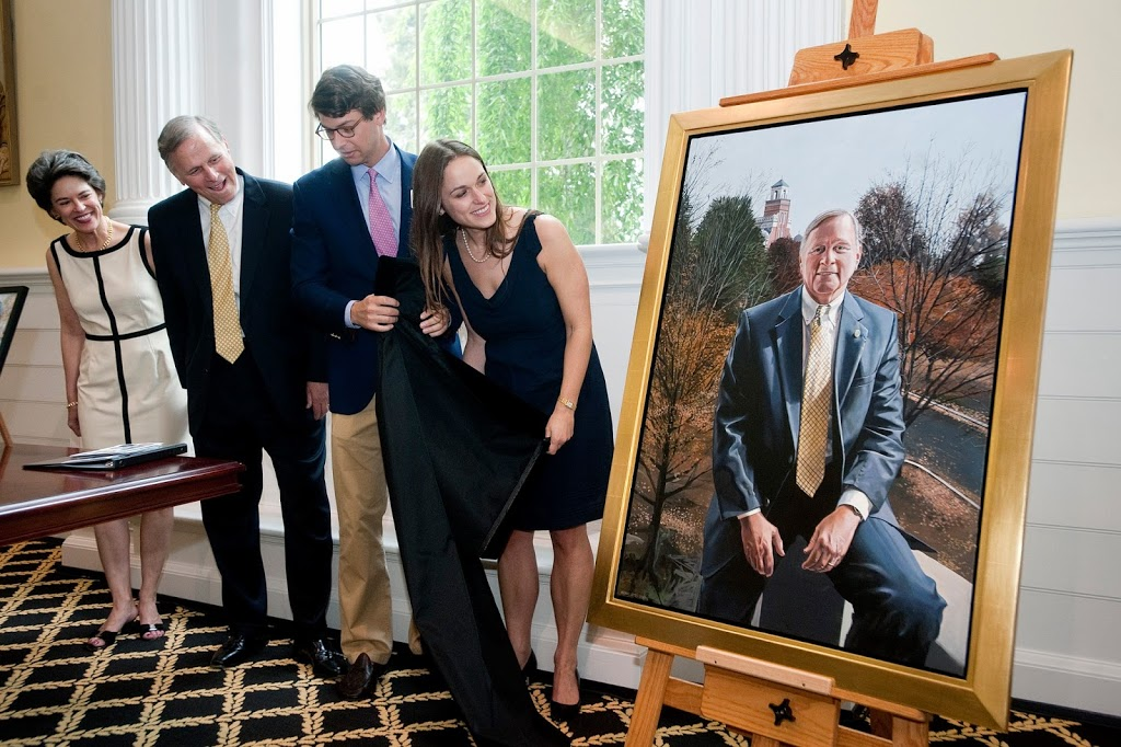 Randolph College President John E. Klein and his family see the newly- unveiledpresidential portrait during a reception at Lipscomb Library.