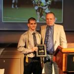 John Grundy '14 receives the Scholar Athlete of the Year award from Randolph English professor Dan Stiffler.