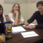 Photo of students and professor working together