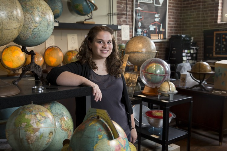 Photo of Katie Snyder with globes