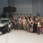 Photo of students with car