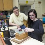 Professor of Psychology Rick Barnes and Sarah Ballard-Abbott '16 look through historic psychological tests in the College's psychology lab.