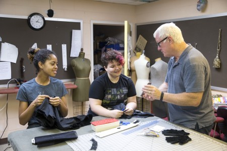 Theatre professor Ken Parks reviews photos of the stage illusion tests with students Morgan Wardlaw '17 (left) and Daisy Howard '17.