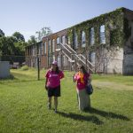 Danielle Currier (left) and Ayla Hagen ''18 visit the site of a Lynchburg mill that closed in the 1950s.