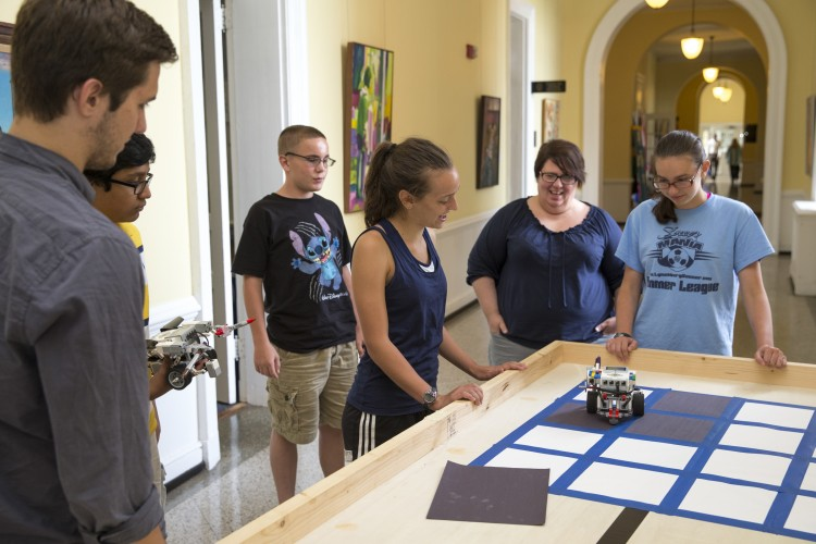 Campers built and programmed robots to play the Game of Life on a physical grid in Main Hall.