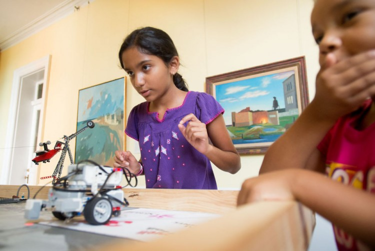 Nikitha Prabhu (left) and Shiloh Mack test their lego robot at the Tech Cats Coding Camp on Wednesday at Randolph College. (Photo by Jill Nance)