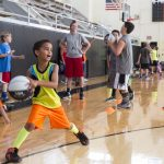 A camper prepares to pass the ball at Randolph's Skill Builder Hoop Camp 2015.