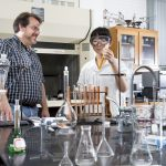 Chemistry professor Bill Bare works with Di Bei ''18 in the lab during the 2015 Summer Research program.