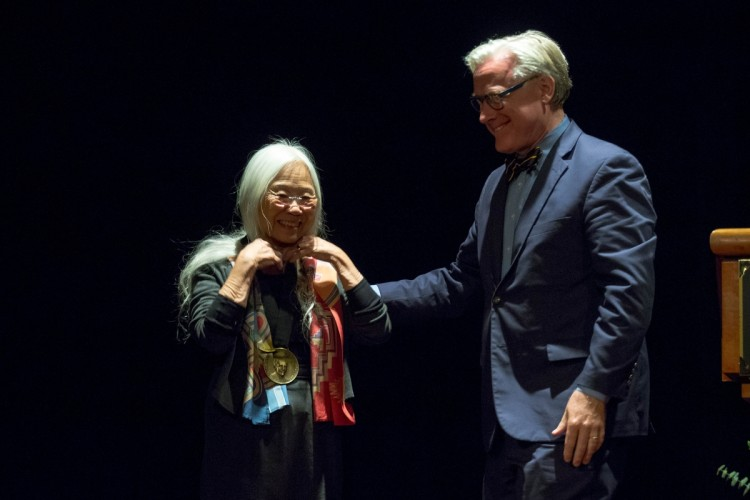President Bradley W. Bateman presents the Pearl S. Buck Award to Maxine Hong Kingston.