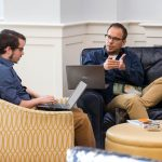 Will Andress '17 and Gordon Steffey meet to discuss one of their readings in the Student Center.