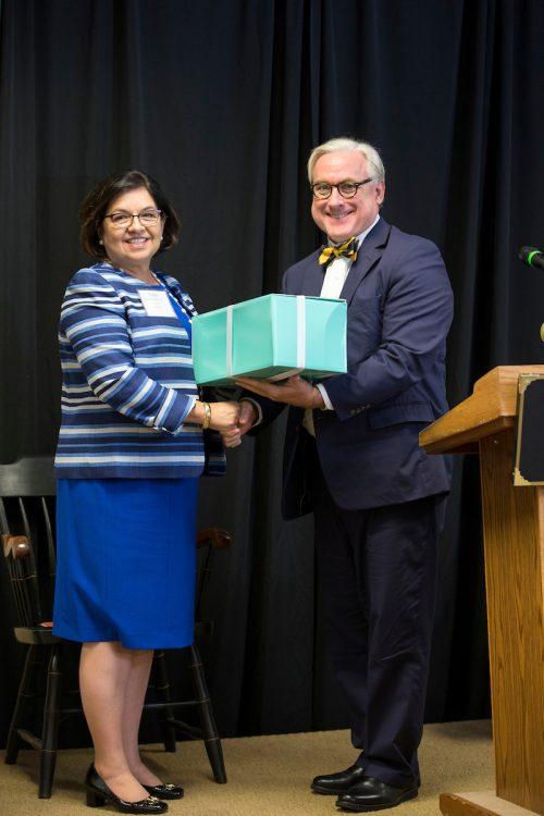 Edna Aguirre Rehbein '77 receives her Alumnae Achievement Award from President Bradley W. Bateman in September 2015.