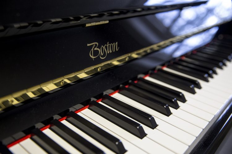 A close-up of one of the new Boston upright pianos