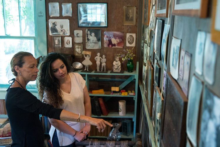 Shaun Spencer-Hester shows Nour Elkhamra '17 a wall of photos kept by her grandmother, Anne Spencer.