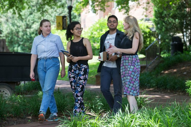(From left) Sustainability coordinator Sara Woodward '16, Shataaxi Joshi '19, Arnav Upadhyay '19, and the Herzog Family Chair of Environmental Studies Karin Warren discuss their project while walking on campus.