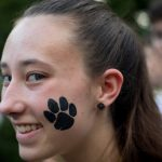 New student with WildCat paw print tattoo
