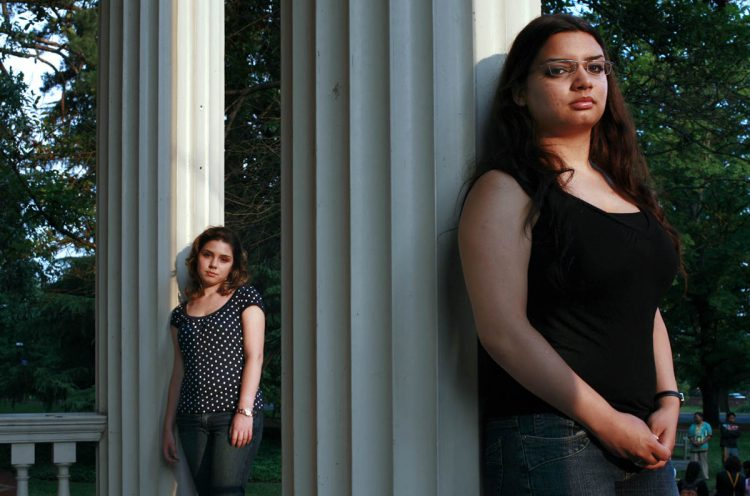 This photo of Matea Osti '08 (left) and Marwa Abdel Latif '09 ran in the New York Times in 2006. (Credit: Josh Meltzer/The New York Times/Redux)