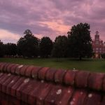Sunset over Main Hall and the Red Brick Wall