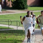 (Left) Daniel Bennett-Blake '21 inches ahead of Bradley Strober '18 during Randolph's first-ever Panathenaic Torch Relay in September.