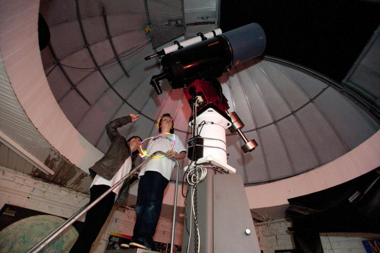 Students use the telescope in the Winfree Observatory during a recent Star Party.