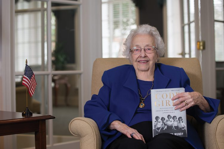 Dorothy Braden Bruce '42 holds a copy of the recently released book that details her previously top secret experiences as a WWII codebreaker for the U.S. Army.