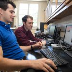 Yuriy Snyder '19 (left) and chemistry professor Jesse Kern test a molecule using computational modeling software