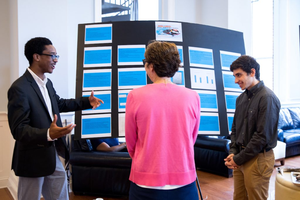 Josh Yeast '19 (left) and Damien Douglas present a poster about the project,