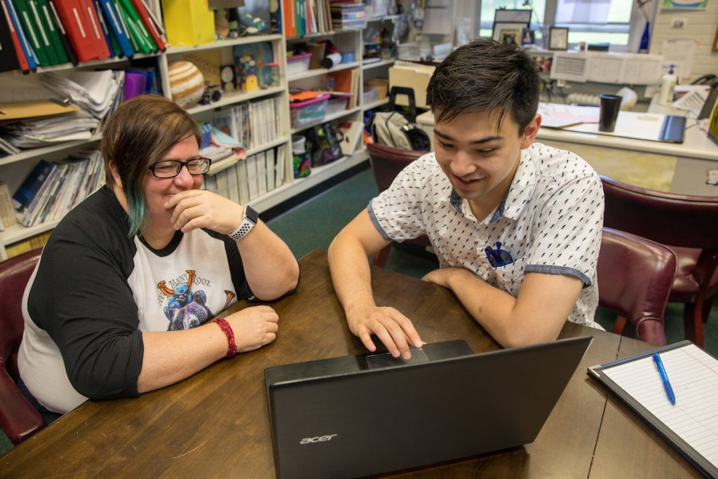 Physics professor Katrin Schenk and Emad Davis '19 work to develop their web application to help caregivers monitor Alzheimer's patients