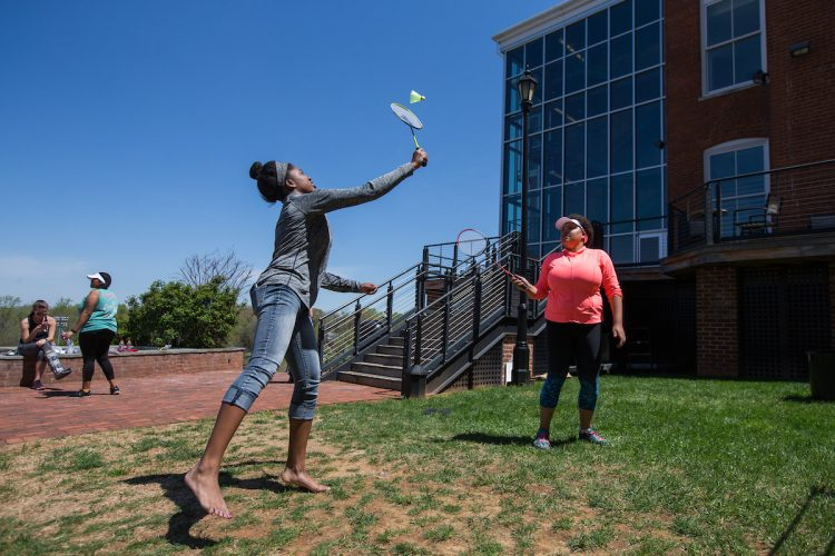 Taylor Samuels '18 (left) and Stacey Samuels '18 play badminton during Macon Activities Council's Outdoor Fest in April.
