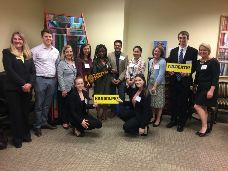 Students and alumni show their school pride during the career immersion trip to Richmond, Va.