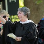 Paula Wallace, associate dean of the College, waves to the crowd at the 2018 Commencement ceremony.