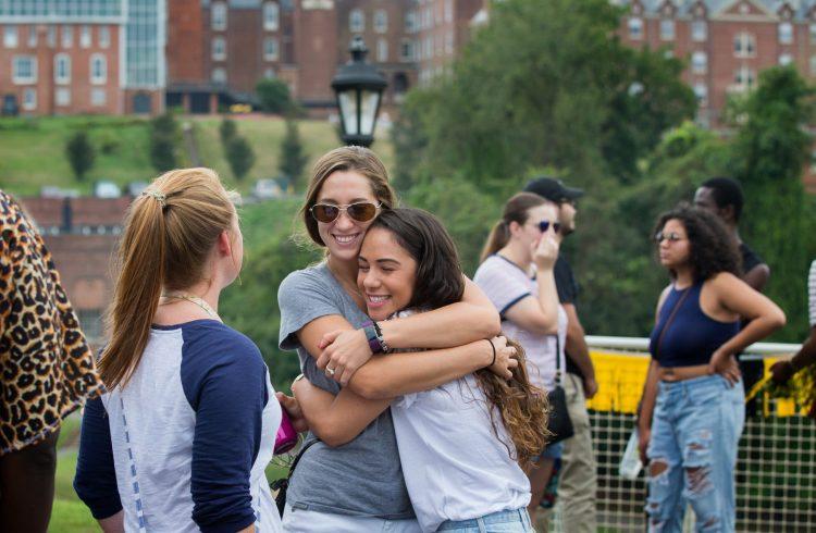 Alumnae embrace at Homecoming