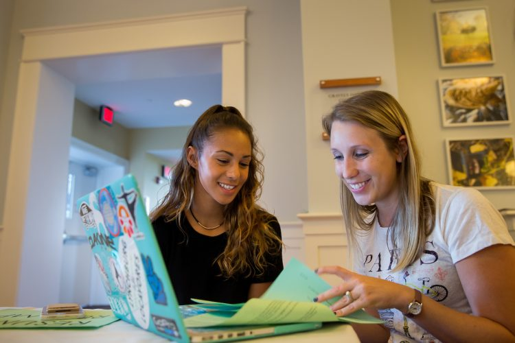 Maegan Crews Fallen (right) works with a student during a resume revamp session