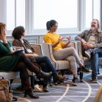 A panel discussion from Randolph College MFA faculty takes place during the winter residency program.