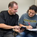 Professor Jeff Heinfeldt works with a student