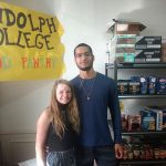 Student volunteers Madeline Owens '20 and Avery Payne '21 helped cut the ribbon for the official opening of the Randolph College Food Pantry on Wednesday.